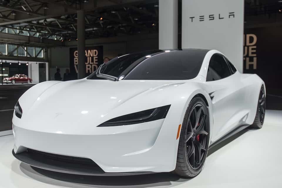 Tesla Roadster and The Bugatti Battle for The Fastest Car